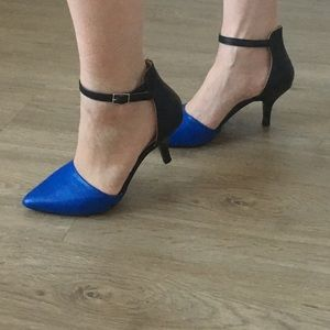 Call it spring blue and black pointed-toe heels